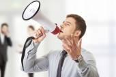 Businessman shouting through megaphone. — Stock Photo