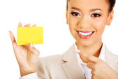 Businesswoman pointing on a card. — Stock Photo