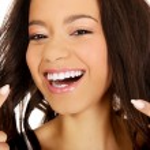 Beautiful woman pointing to teeth. — Stock Photo #73816577