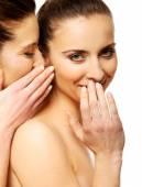 Two beauty women whispering. — Zdjęcie stockowe