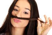 Teen woman putting hair like moustache. — Stock Photo