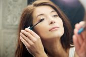 Woman makes light day makeup in bathroom. — Stock Photo