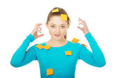 Young woman covered with post it notes. — Stock Photo