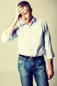 Depressed mature man touching his head — Stock Photo