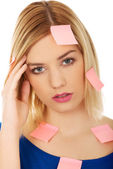 Woman with sticky notes. — Stock Photo