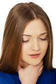 Young woman with a throat pain. — Stock Photo