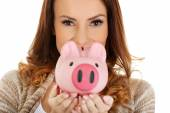 Casual woman holding piggy-bank. — Stock Photo