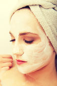 Woman relaxing with face mask. — Stock Photo