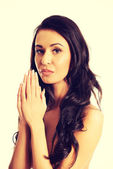 Topless woman clenches hands to pray — Stock Photo