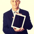 Happy businessman holding digital tablet — Stock Photo #75671789