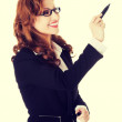 Businesswoman writing with pen on abstract screen. — Stock Photo #75676639