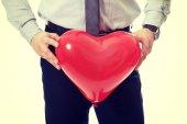 Man with heart balloon. — Stock Photo