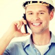 Contractor in hardhat talks on his cell phone. — Stock Photo #75788289