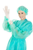 Doctor putting sterilized medical glove. — Stock Photo