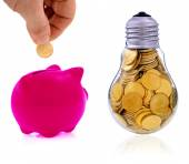 Traditional  lightbulb with  golden coins and pink piggy bank — Stockfoto