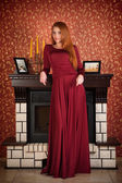Young redheaded girl in evening dress — Stock Photo