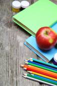 Books, pencils and an apple  — Stock Photo