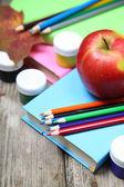 Books, pencils and maple leaf — Stock Photo