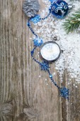 Christmas decorations and clock in the snow  — Stock Photo