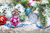 Christmas decorations and clock  in the snow — ストック写真