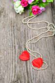 Two red hearts with beads of pearls  — 图库照片