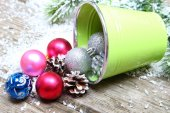 Christmas ornaments in a decorative bucket — Stock Photo