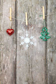 Christmas decorations hanging on a rope  — Stock Photo