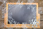 Snowflakes on a chalkboard. — Stock Photo