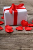 Holidays gift and red hearts — Stock Photo