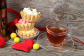 Cup of tea, cakes and red hearts  — Stock Photo