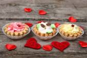 Cakes and red hearts — Stock Photo