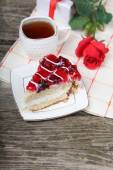 Cup of tea, piece of cake and red rose — Stock Photo
