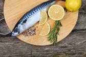 Raw fish with lemon and rosemary — Stock Photo