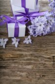 Gift boxes and blue hyacinth  — Stock Photo