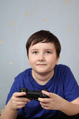 Boy with a joystick playing computer game — Stock Photo