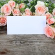 Bouquet of pink roses and greeting card  — Stock Photo #68175101