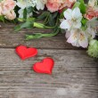 Bouquet of of beautiful flowers and red hearts  — Stock Photo #68175463