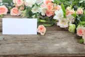 Bouquet of beautiful flowers and greeting card — Stock Photo