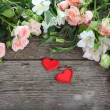 Beautiful flowers and red hearts  — Stock Photo #69289739