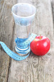 Glass of water, apple and measuring tape — Foto de Stock