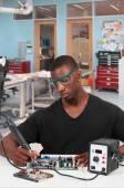 Man soldering — Stock Photo