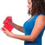 Beautiful woman opening a present — Stock Photo #54609413