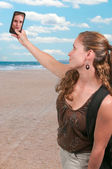 Woman taking a selfie — Stock Photo