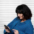 Woman Texting in Bed — Stock Photo #58168327