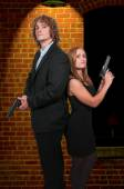 Couple with Guns — Foto Stock