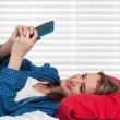 Woman Texting in Bed — Stock Photo #59839493