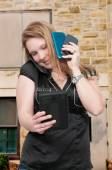 Woman with cell phones and a tablet — Stock Photo