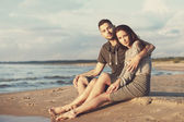 Attractive couple on the beach — Stock Photo