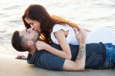 Couple lying on the beach — Stock Photo