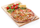 Delicious pizza on the table — Stock Photo